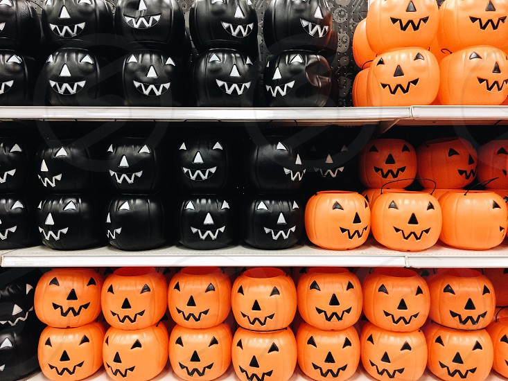 black and orange jack o lantern pale photo