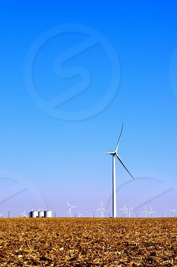 Windmills towers over a Northwestern Indiana (USA) farm field photo