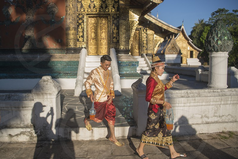 a traditional dresst couple at the wat xieng thong in the town of Luang Prabang in the north of Laos in Southeastasia. photo