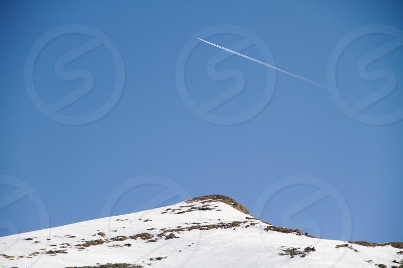 Mountain snow ski people lift pist sky cloud avoriaz trees sun sky plane blue photo