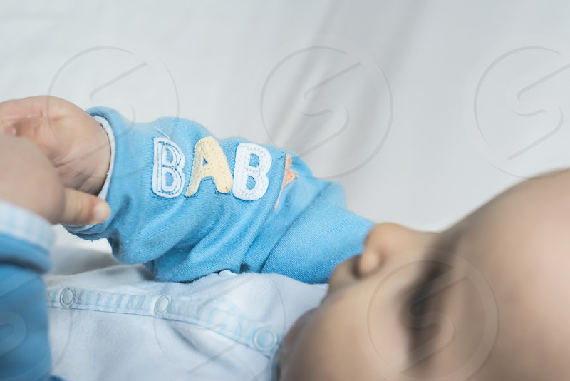 Baby in a bed. Text baby photo