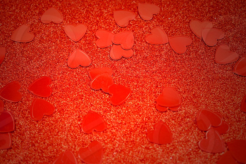 Red background with hearts stock images. Red hearts background. Red Valentine Day glitter background photo
