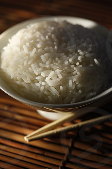 ricegrainsbowl of rice chopsticks white rice photo