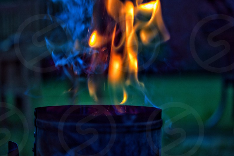 fire burning on a gray cylindrical container photo