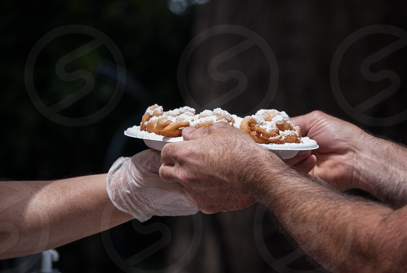 Hands funnel cake pancake sugar sweet fair concession eat snack treat food dessert  photo