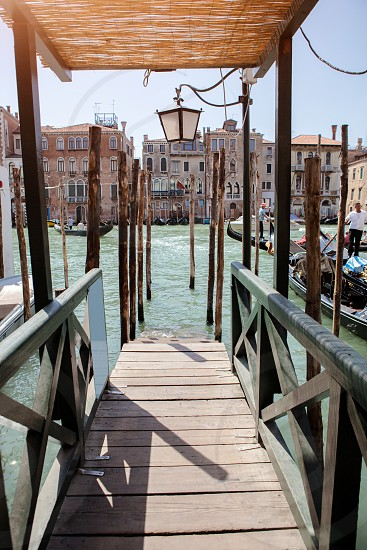 Pier on San Marco Canal and view on San Giorgio Maggiore Venice Italy. Gangway in Venice. photo