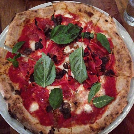 The Luana pizza; sausage soppressata hand crushed tomatoes. Opt for the buffalo mozzarella and a side of fresh basil. photo