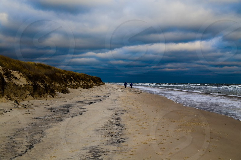 Beach winter cold ice weather ocean clouds landscape nature people horizon  photo