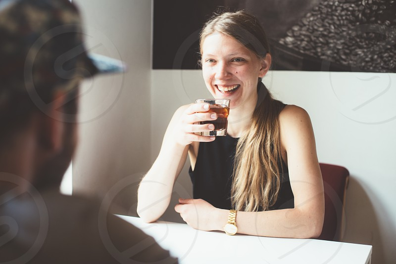 Young woman drinking cold brew coffee photo