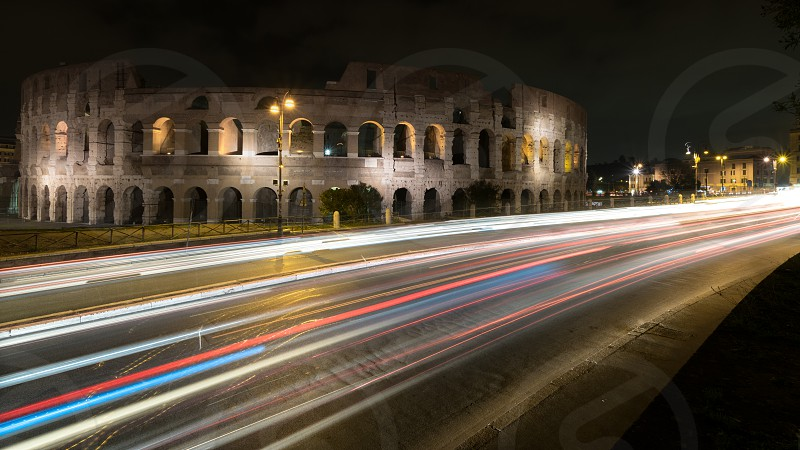 Lights at the Colosseum Night landscape of one of the most famous places in the world surrounded by the lights of the Italian capital. photo
