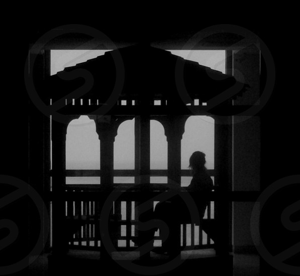 man sitting on cottage silhouette photo