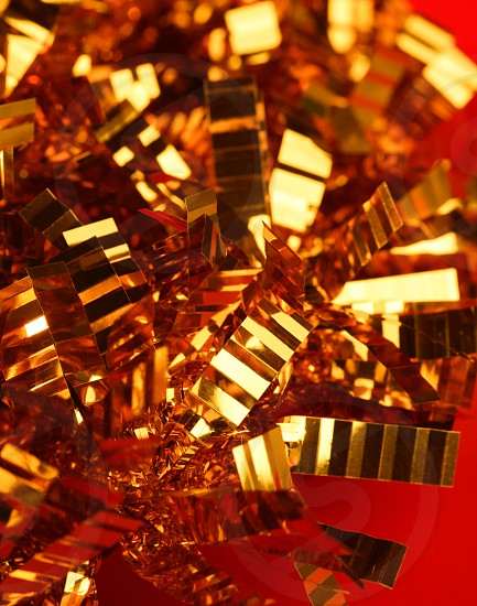 Abstract composition of christmas golden decoration over red background photo