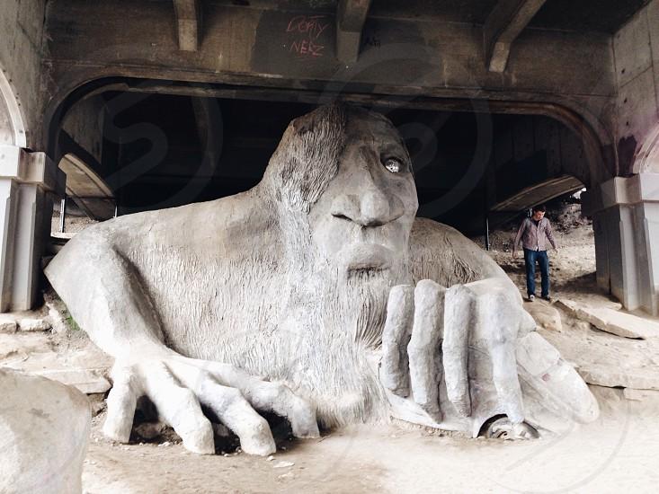 man crawling statue photo