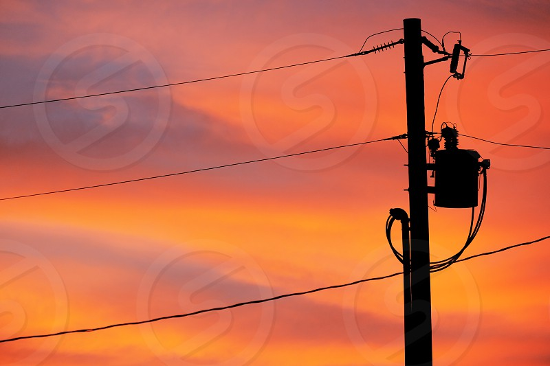 Power line against sunset in sky. photo