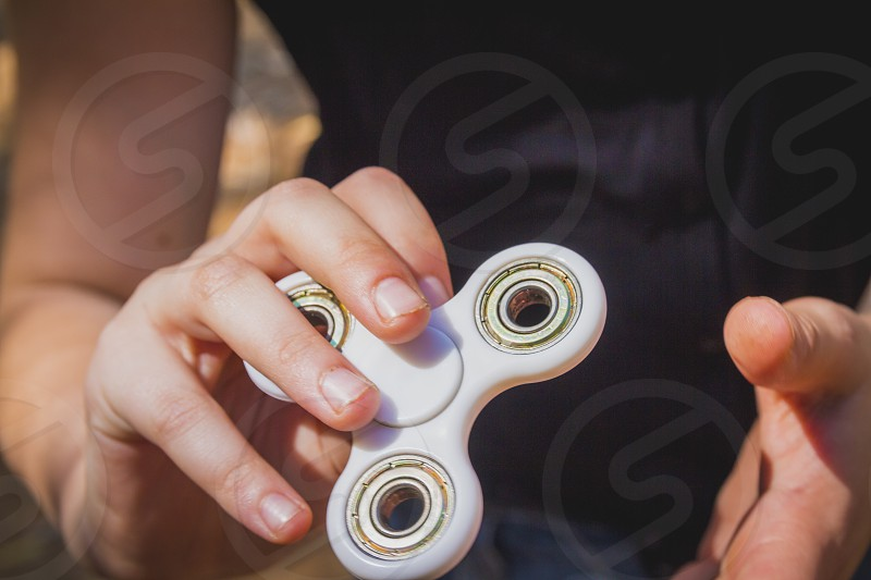 Young girl play with fidget spinner photo