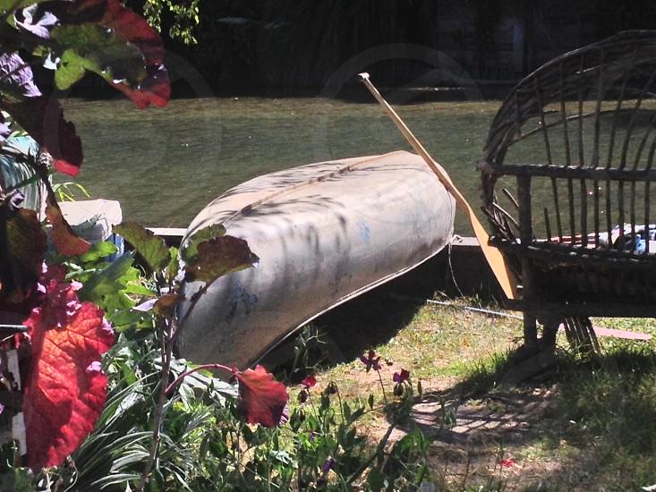 black metal boat with brown wooden oar photo