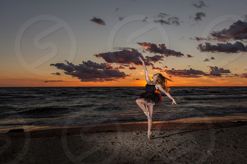 ballerina on the beach at sunset photo
