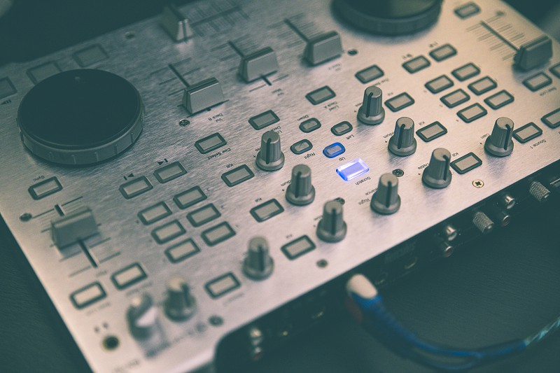 Detail of an audio control panel used by the DJ to mix live music photo