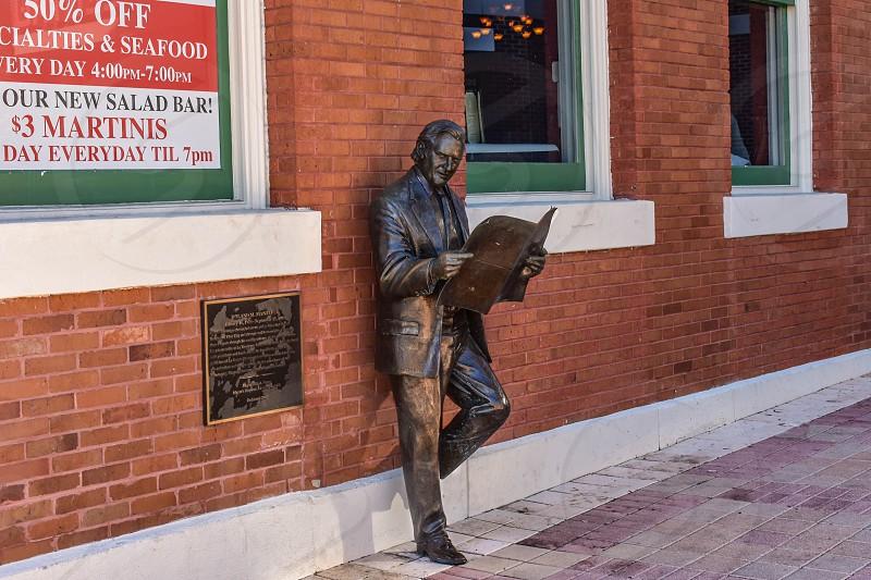 Ybor City Tampa Bay Florida. January 19  2019  Roland Manteiga statue on Centro Espanol building background in 7th Ave. photo
