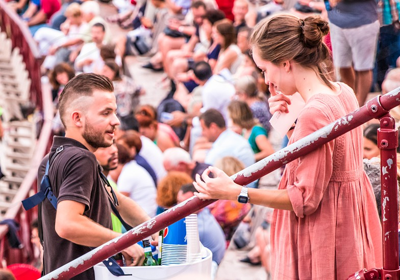 Young Vendor Selling Beverage Products To A Customer In Arena Outdoor Theater Verona Italy photo