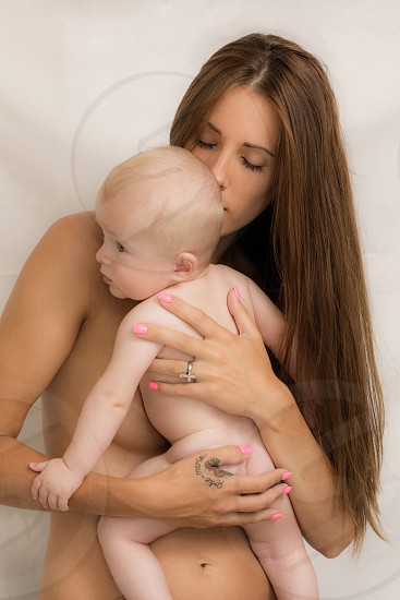 A beautiful young mother with her young baby. photo
