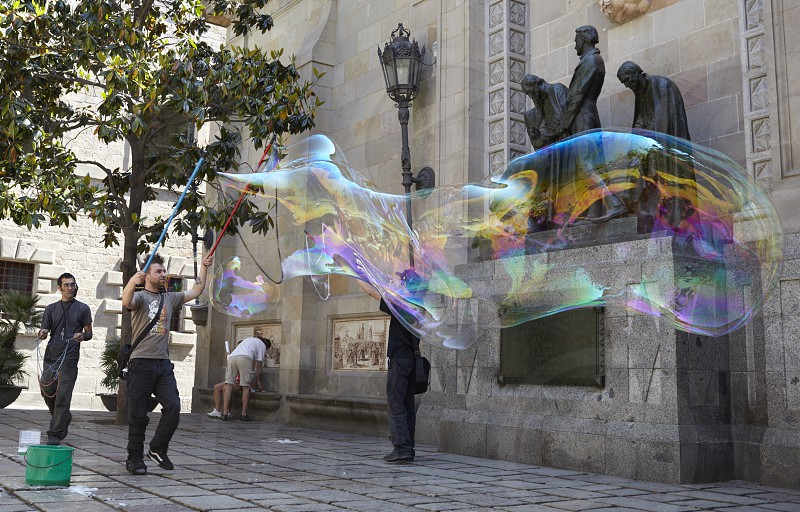 BARCELONA SPAIN - MAY 23: Soap bubbles performance in the Gothic Quarter (Barri Gotic) on May 23 2012 in Barcelona Spain. photo