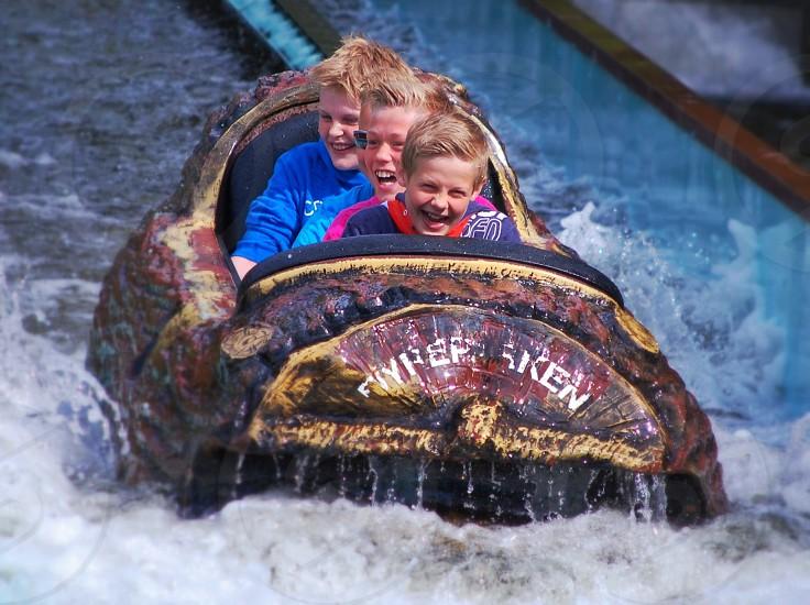 three children in log water ride photo
