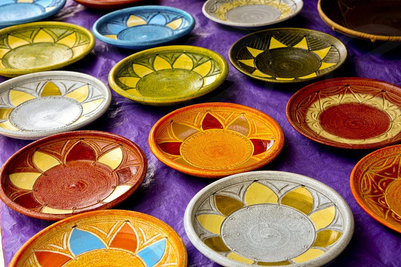 Color African Plates at an Outdoor market in Accra Ghana photo