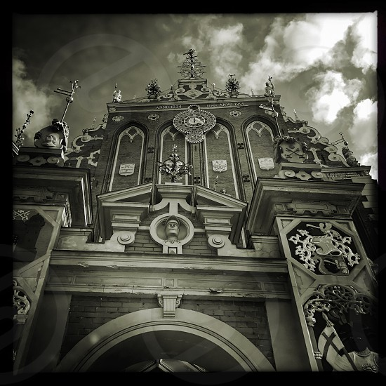 Outdoor day black and white monochrome Square filter house of the Blackheads Riga Latvia Europe European attraction architecture classic building Europe European travel tourism wanderlust sepia photo