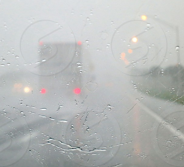 Truck traffic street lamps in the rain and mist photo