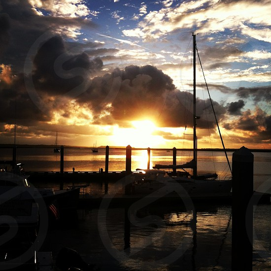 view of wooden dock at sunset photo