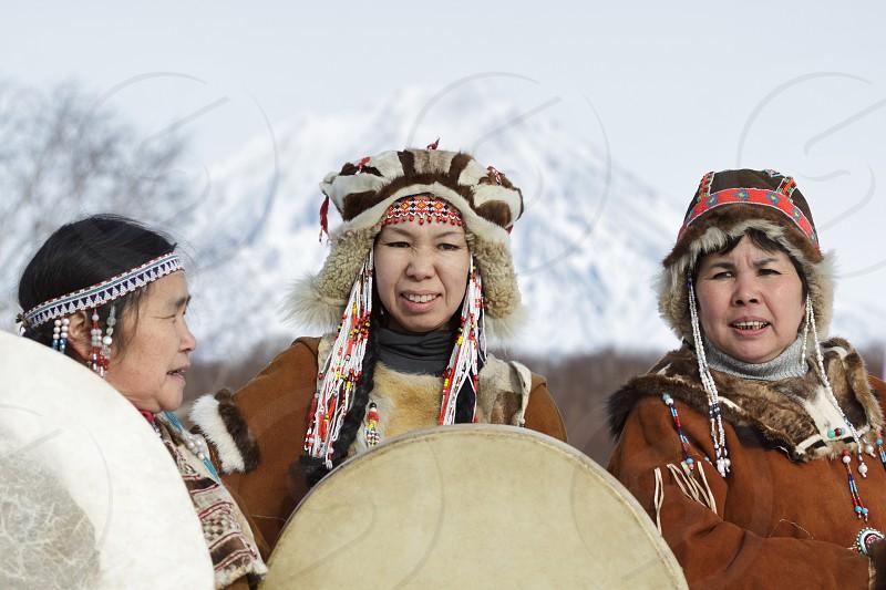 KAMCHATKA PENINSULA RUSSIA - FEB 5 2012: Womens dressed in the Koryak national costume with tambourines. Public concert Koryak National Folk Dance Group. Eurasia Russian Far East Kamchatka Region. photo