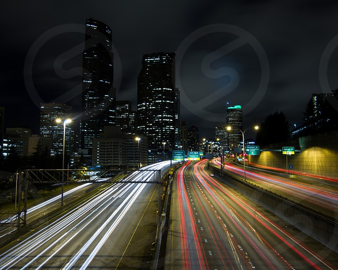 white and red passenger vehicles light streaks photo