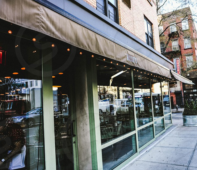 light strand brown awning over a glass window restaurant photo
