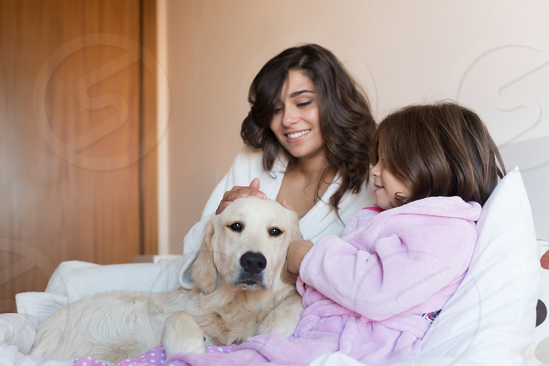 mother mom daughter dog golden retriever bed bedroom robe pajama  photo