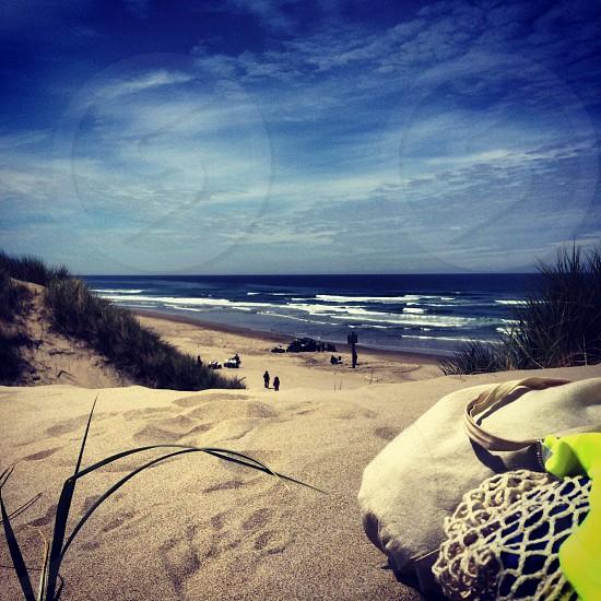 bag on sand seashore view photo
