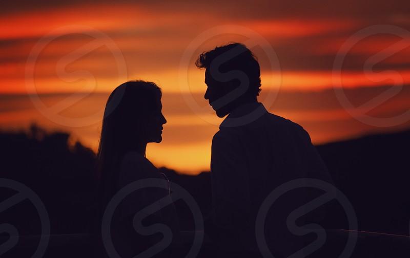 romantic sunset  vibrant love passion romance couple man woman sunset joy silhouette sky clouds los angeles california photo