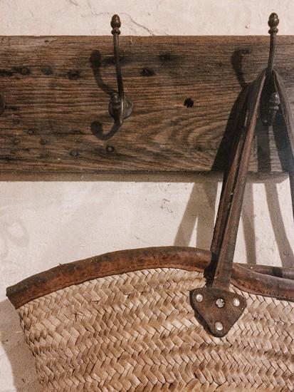 Straw woven bag hanging hook vintage rustic photo