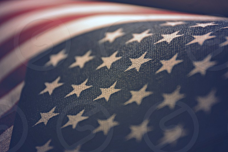 Close up of American Flag Stars in foreground stripes in background photo