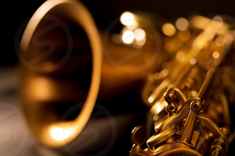 Tenor sax golden saxophone macro with selective focus on black photo