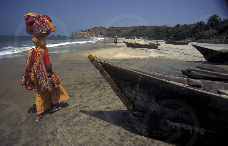 a Indian Saler at the beach of Colva in the Province Goa in India. photo