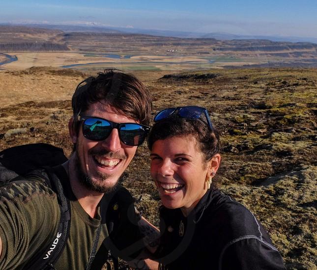 happy couple are enjoying adventure trip in Iceland photo