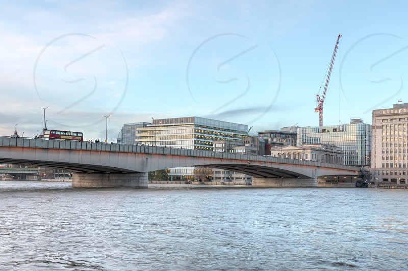 London bridge seen from the south bank of the river Thames in the heart of London. photo