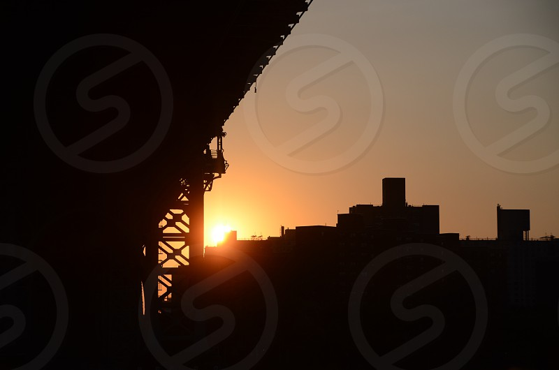 sun shining over bridge photo