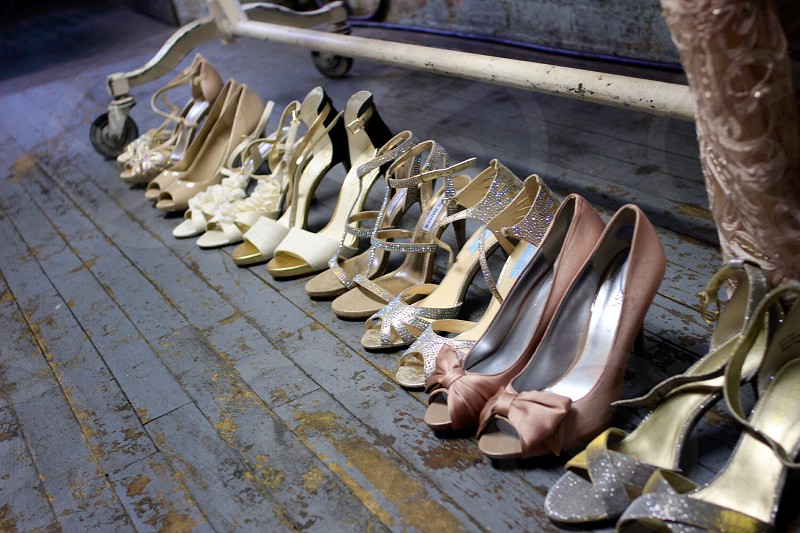 high heels lined up on wood floor photo