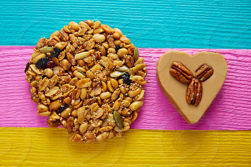 Mexican candy sweets Palanqueta with peanuts and cajeta heart with pecan nuts photo