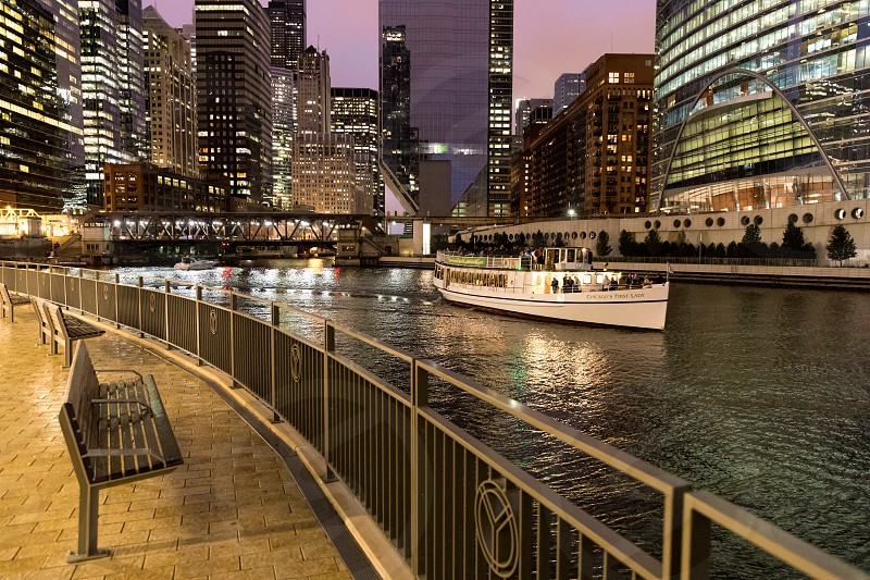 Boat tour passing along on the Chicago river in Chicago Illinois at night. photo
