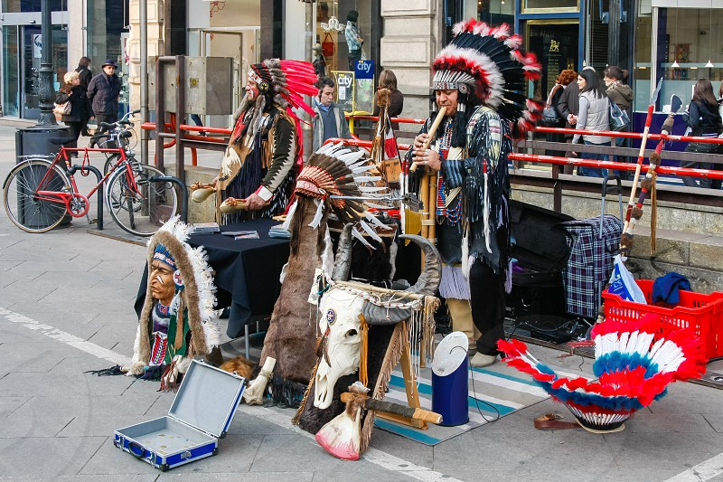 Buskers dressed as american red indians making music in Milan photo