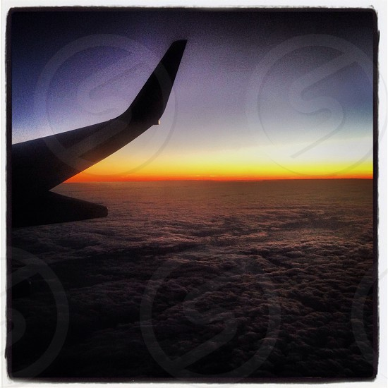 Sunset from the skies in an aeroplane.  photo