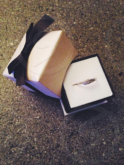 silver ring in ring box with bow photo